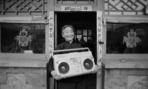 The proud owner of a ghettoblaster in Beijing, China, 5 February 1985