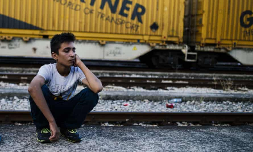 A migrant waiting for a train to Serbia at Gevgelija, on the Macedonian-Greek border.