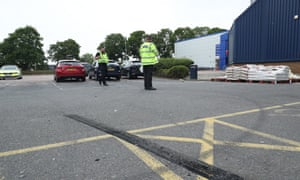 Police survey the aftermath of the Stevenage car event that resulted in 17 injured.