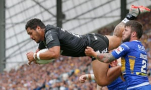 Hull's Bureta Faraimo takes off for a spectacular try.