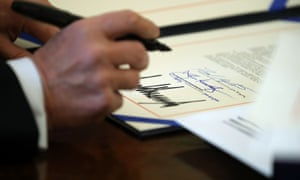 Donald Trump signs sweeping tax reform legislation that he touted as a job creation package into law in the Oval Office at the White House on 22 December.