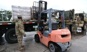 Florida National Guard dealing with supplies at their depot in West Palm Beach