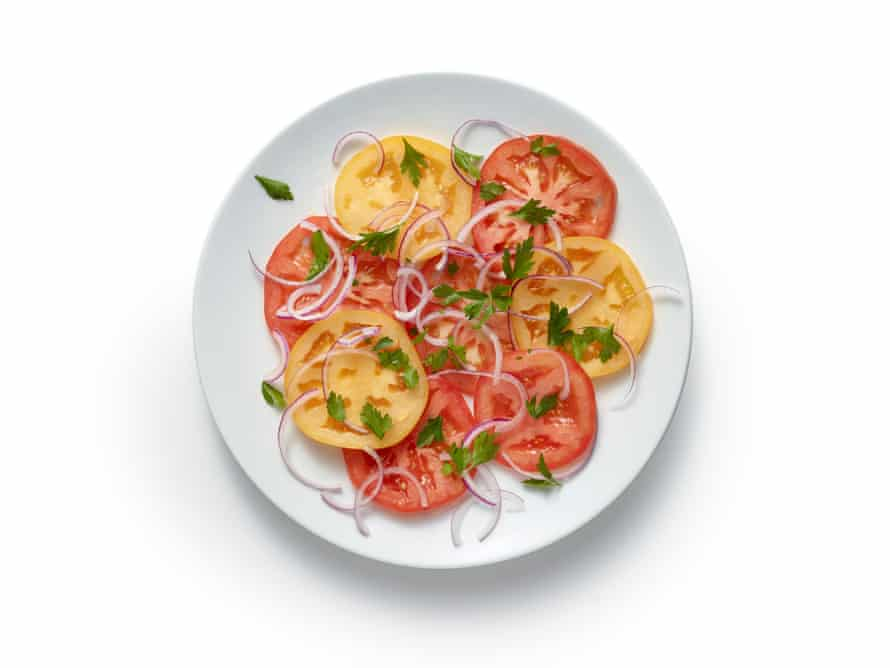Make a salad of tomatoes and the red onion and sprinkle with lemon juice.