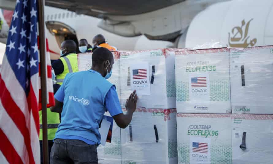 A Unicef worker checks boxes of the Moderna Covid-19 vaccine after their arrival at the airport in Nairobi, Kenya.