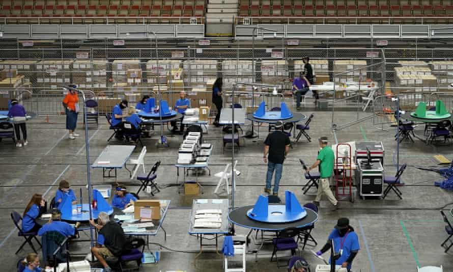 Contractors working for Cyber Ninjas examine Maricopa county ballots in Phoenix on 6 May.