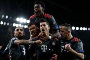Bayern Munich's Robert Lewandowski celebrates scoring their first goal.