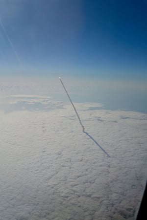 Space shuttle Endeavour launching into orbit for the last time in 2011