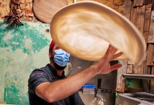 Chef Roberto Mezzapelle tosses pizza dough in the air at Refeitório Senhor Abel restaurant the night before the reinstatement of the state of emergency during the COVID-19 Coronavirus pandemic. Lisbon