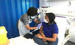 Kemi Badenoch, the equalities minister, taking part in a coronavirus vaccine trial