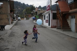 Girls play with a balloon on the quiet main street in Filo de Caballos.