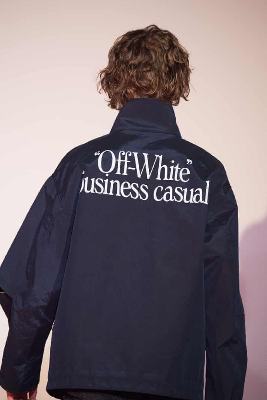 A model in a jacket bearing the words 'business casual' on the back