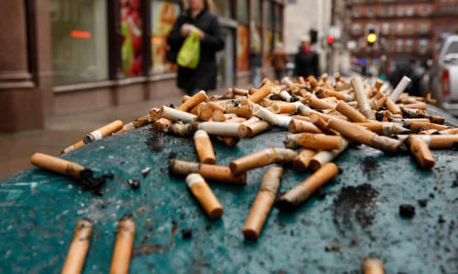 Cigarette butts on a Glasgow litter bin.