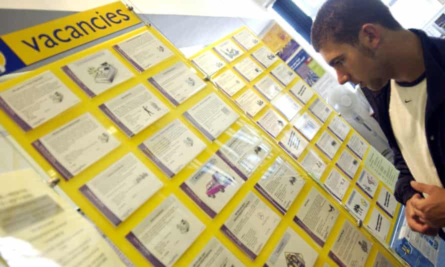 A man looking at job adverts.