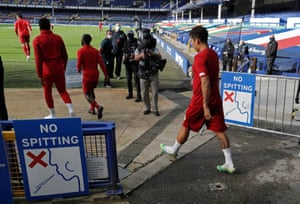 Liverpool players take the field to warm up at Goodison Park.