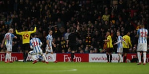 Watford's Troy Deeney is shown a red card by referee Michael Oliver.