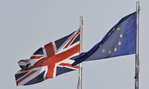 A UK flag flies next to the EU flag