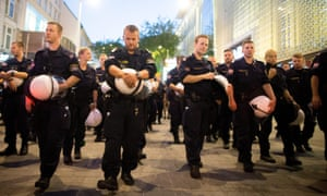 Police remove their helmets as the march made its way through Vienna.