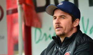 Joey Barton watches the match between Barnsley and Fleetwood Town.