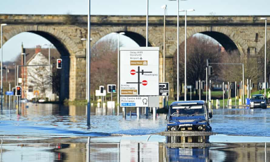 A motorist drives through the flood waters on Kirkstall Road in central Leeds on 27 December.