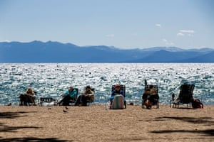 Tourists enjoy the beach next to Lake Tahoe on 8 September.
