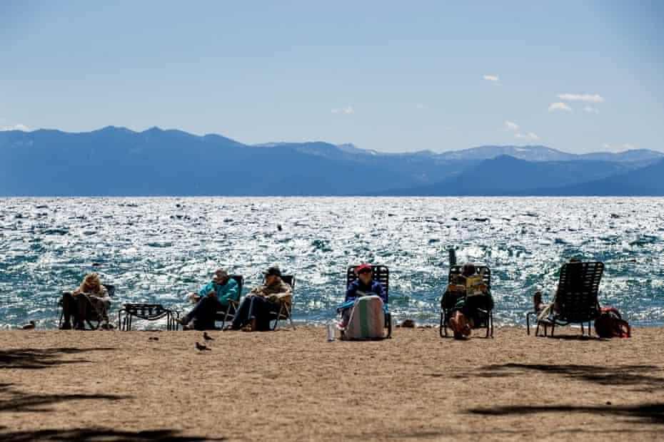 Tourists enjoy the beach next to Lake Tahoe on 8 September.
