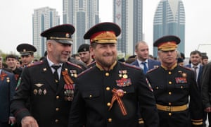 Chechen leader Ramzan Kadyrov, centre, in front of the Grozny-City complex.