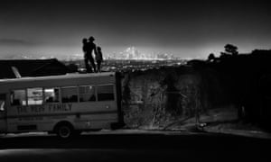 Izzy Reis and his two daughters enjoy the view from the top of the family bus as the Los Angeles city lights flicker below.