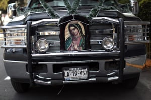 A car is adorned to celebrate the feast of the Virgin of Guadalupe