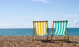Deck chairs on Brighton beach.