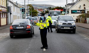 Members of An Garda Siochana performing random vehicle checks in the village of Muff, County Donegal, on the border with Northern Ireland.