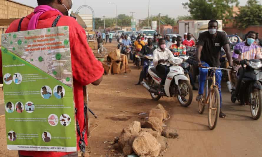 A man uses a microphone to deliver a public service announcement about the coronavirus outbreak in Ouagadougou, Burkina Faso