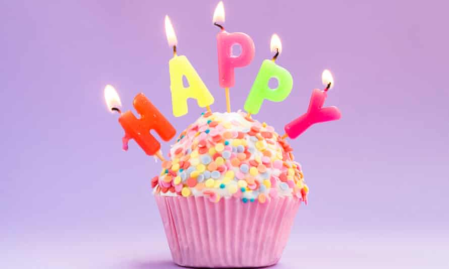 Happy birthday cup cake with candles