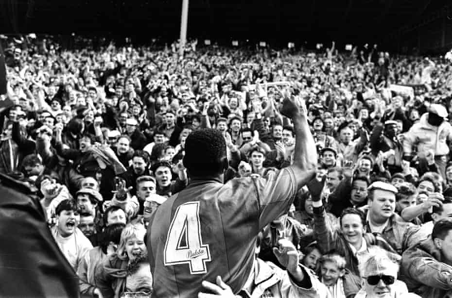 Andy Gray celebrates a famous victory with the Palace fans.
