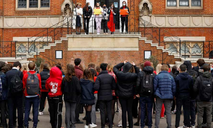 Female pupils on balcony stage a protest at Highgate School in London.