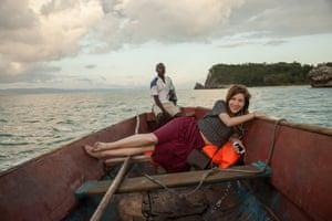 Kim on a boat to Ile-a-Vache.