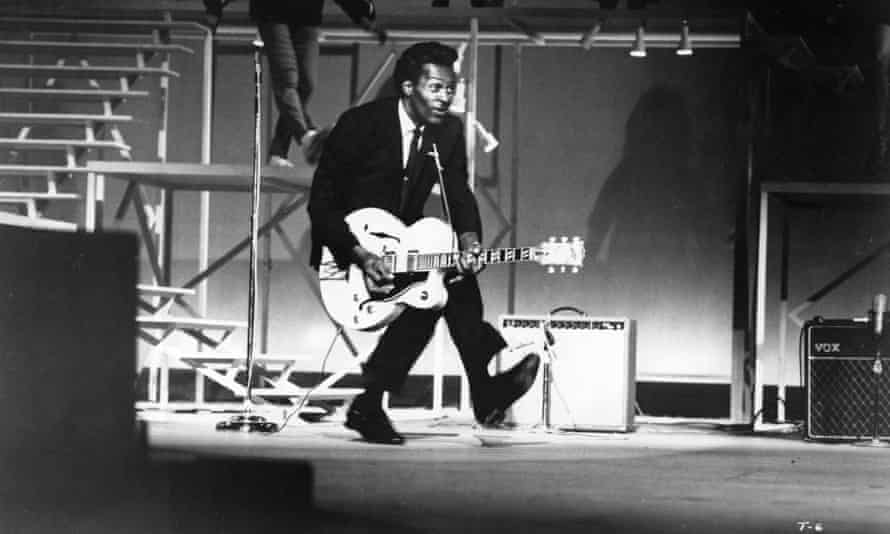 Chuck Berry performing his 'duck walk' on stage in Santa Monica, California, in 1964.