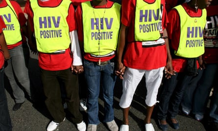 Demonstrators in South Africa hold hands during a protest in support of the Treatment Action Campaign global call to action on tuberculosis and HIV/Aids.
