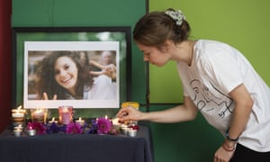 Aiia Maasarwe's sister says she realised her missing sister had been found dead in Melbourne from the television news. People gathered to hold a vigil in memory of Aiia on Friday
