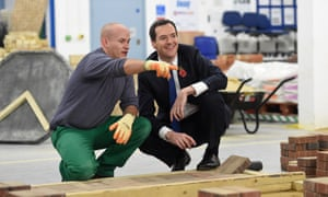 George Osborne speaks with prisoner Jason Locke during a visit to Brixton prison