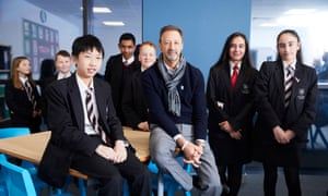 Steve Murrells, the Co-operative Group chief, with pupils at the Co-op academy Manchester