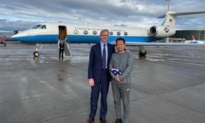 The US special representative for Iran, Brian Hook, stands with Xiyue Wang in Zurich, Switzerland