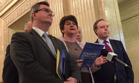 Arlene Foster, the DUP leader, speaks to the media alongside party colleagues in Belfast on Monday