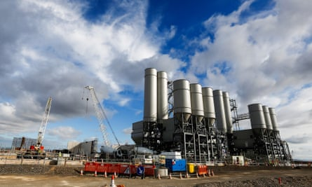 The concrete batching plant stands on the horizon as work recommences at the Hinkley Point C nuclear power station, operated by Electricite de France SA's (EDF), near Bridgwater, U.K.