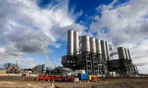 The concrete batching plant stands on the horizon as work recommences at the Hinkley Point C nuclear power station