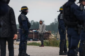 French riot police are seen at the Calais camp