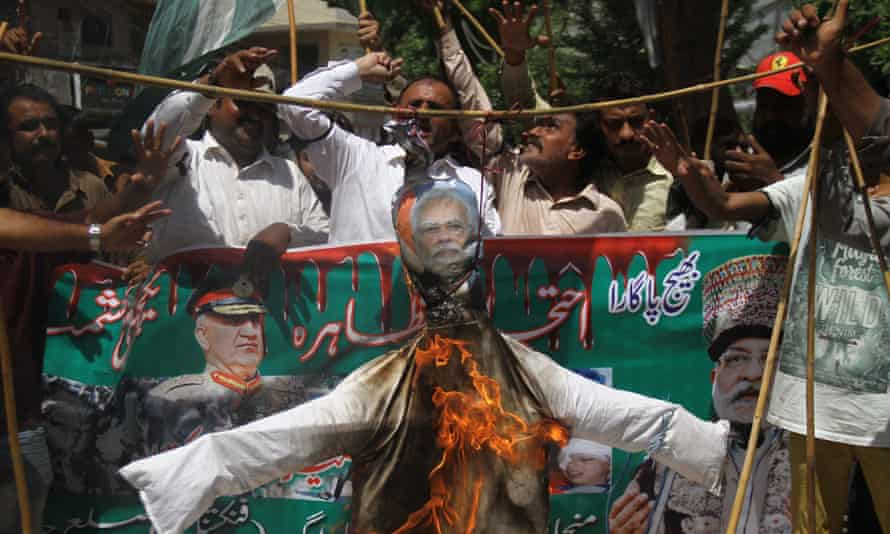People burn an effigy of the Indian prime minister, Narendra Modi, in Hyderabad, Pakistan