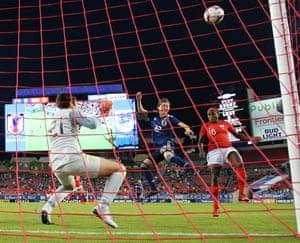 Chioma Ubogagu of England heads the ball over the bar.