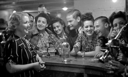 Drinkers in a hotel bar on the Isle of Man, 1939. Susan Ehrenzweig's mother is third from the left.
