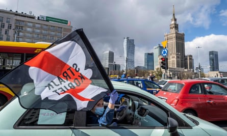 Drivers with flags take part in a protest of Polish women's rights activists using cars and bicycles to block central Warsaw.