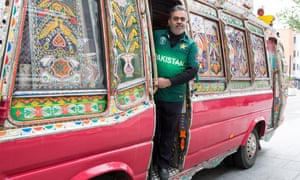 Pakistan cricket supporter and businessman Dalawar Chaudhry with his themed bus in Southall.